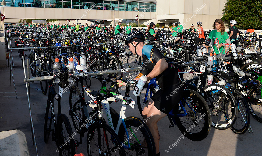 Volunteers help athletes find their bicycles during the first transition of the 2017 IRONMAN Wisconsin on Sunday, September 10 in Madison