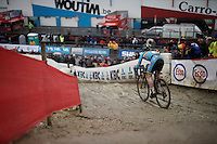 Eli Iserbyt (BEL) descending the muddy slopes<br /> <br /> U23 men's race<br /> <br /> UCI 2016 cyclocross World Championships / Zolder, Belgium