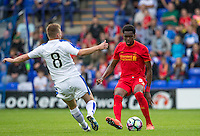 Ovie Ejaria of Liverpool  takes on Jay Harris of Tranmere Rovers during the 2016/17 Pre Season Friendly match between Tranmere Rovers and Liverpool at Prenton Park, Birkenhead, England on 8 July 2016. Photo by PRiME Media Images.