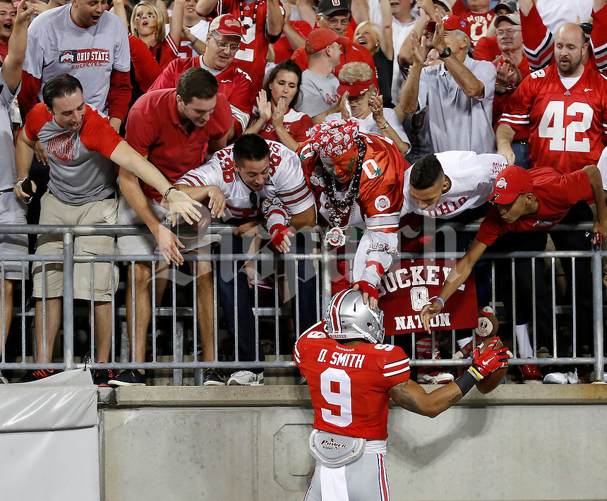 Ohio State Buckeyes wide receiver Devin Smith (9) celebrates with fans after catching a touchdown pass during the fourth quarter of the NCAA football game against the Cincinnati Bearcats at Ohio Stadium in Columbus on Sept. 27, 2014. (Adam Cairns / The Columbus Dispatch)