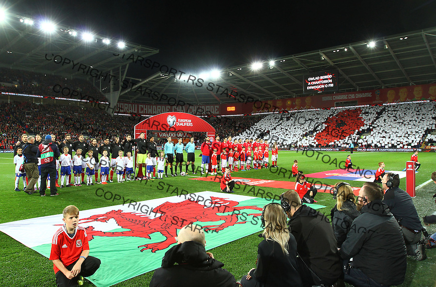(copyright &amp; photo: STARSPORT)<br /> 12.11.16 World Cup Qualifier -  European Group D - Wales v Serbia -<br /> Supporters of Wales pay their respects during the National Anthems