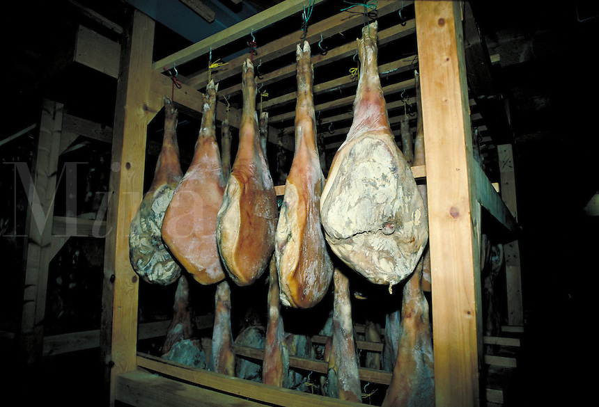Cured meats hanging on drying racks. Disentis, Switzerland Europe.