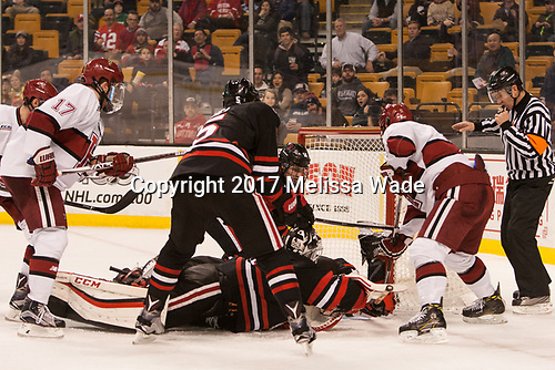 David Cotton (BC - 17), Ryan Shea (NU - 5), Ryan Ruck (NU - 41), Garret Cockerill (NU - 14), Tyler Moy (Harvard - 2), Kevin Shea - The Harvard University Crimson defeated the Northeastern University Huskies 4-3 in the opening game of the 2017 Beanpot on Monday, February 6, 2017, at TD Garden in Boston, Massachusetts.