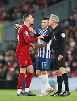 30th November 2019; Anfield, Liverpool, Merseyside, England; English Premier League Football, Liverpool versus Brighton and Hove Albion; Jordan Henderson of Liverpool argues with referee Martin Atkinson - Strictly Editorial Use Only. No use with unauthorized audio, video, data, fixture lists, club/league logos or 'live' services. Online in-match use limited to 120 images, no video emulation. No use in betting, games or single club/league/player publications