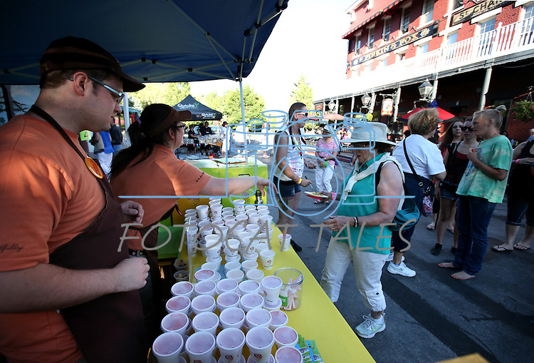 Melanie Meehan-Crossley takes a sample from the Jamba Juice booth during the 20th annual Taste of Downtown event in Carson City, Nev., on Saturday, June 15, 2013. The event features 44 local restaurants in a fundraiser for the Advocates to End Domestic Violence.<br /> Photo by Cathleen Allison