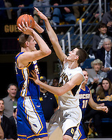 David Kravish of California tries to block the ball during the game against UCSB Gauchos at Haas Pavilion in Berkeley, California on December 19th, 2011.   California defeated UC Santa Barbara, 7-50.