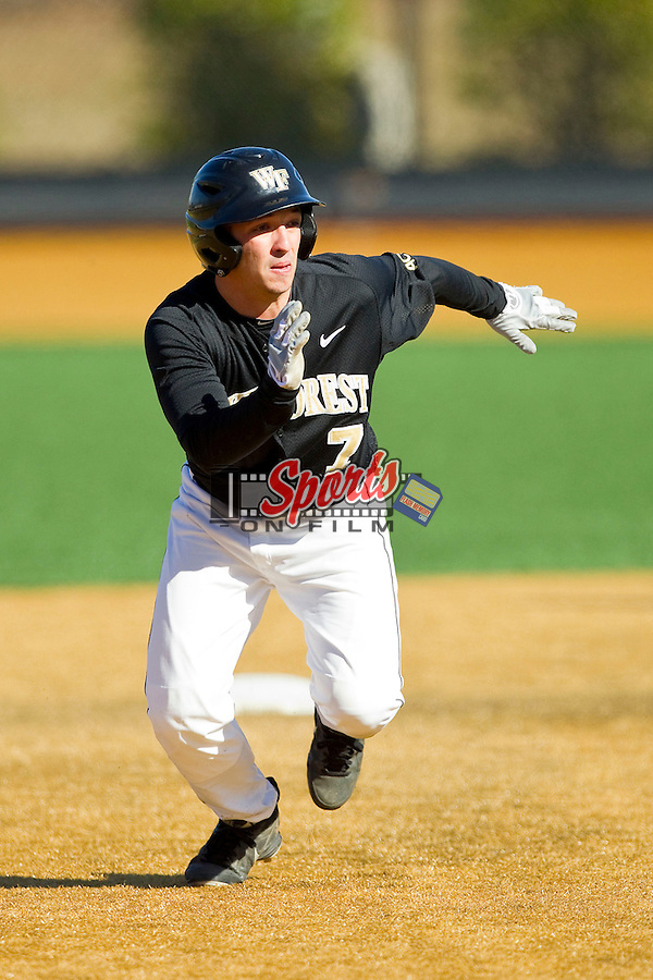 Joey Rodriguez (7) of the Wake Forest Demon Deacons takes off for third base against the Youngstown State Penguins at Wake Forest Baseball Park on February 24, 2013 in Winston-Salem, North Carolina.  (Brian Westerholt/Sports On Film)
