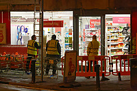 Pictured: Workers assess the damage outside Sainsbury's in Uplands, Swansea, Wales, UK.  Tuesday 13 February 2018<br /> Re: A Sainsbury's shop sign at the Uplands local store in the Uplands area of Swansea has collapsed onto the pavement hitting a woman in south Wales, UK.