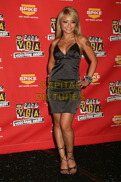 TILA TEQUILA .Spike TV's 2006 Video Game Awards at the Galen Center - Press Room, Los Angeles, California, USA..December 8th, 2006.full length black dress hand on hip halterneck cleavage.CAP/ADM/BP.©Byron Purvis/AdMedia/Capital Pictures