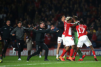 Charlton players and staff race towards goalkeeper, Dillon Phillips to celebrate winning the penalty shoot-out during Charlton Athletic vs Doncaster Rovers, Sky Bet EFL League 1 Play-Off Football at The Valley on 17th May 2019