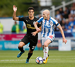 Mikel Merino of Newcastle United tussles with Aaron Mooy of Huddersfield Town during the premier league match at the John Smith's Stadium, Huddersfield. Picture date 20th August 2017. Picture credit should read: Simon Bellis/Sportimage