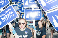 Supporters of Democratic presidential candidate and Massachusetts senator Elizabeth Warren march in the 4th of July Parade in Amherst, New Hampshire, on Thu., July 4, 2019.