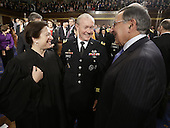 From left, Associate Justice of the Supreme Court Elena Kagan, Chairman of the Joint Chiefs of Staff General Martin Dempsey and outgoing United States Secretary of Defense Leon Panetta talk prior to U.S. President Barack Obama's State of the Union address during a joint session of Congress on Capitol Hill in Washington, DC on February 12, 2013.    .Credit: Charles Dharapak / Pool via CNP