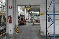- Trezzano sul Naviglio (Milano) - Ri-Maflow, fabbrica recuperata e autogestita dagli ex dipendenti, in lotta dal 2010, dopo una lunga trattativa abbandona la storica sede di via Boccaccio e trasloca nei nuovi capannoni ottenuti in uso dall'attuale proprietaria Unicredit.<br /> <br /> - Trezzano sul Naviglio (Milan) -The Ri-Maflow factory, recovered and self-managed by former employees, has been fighting since 2010. After a long negotiation, leaves its historic headquarters in Boccaccio street and moves into the new sheds obtained in use by the current owner Unicredit.