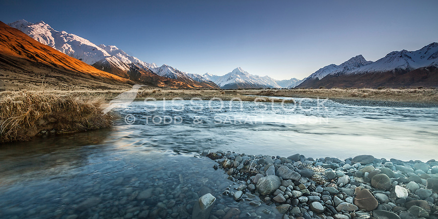 Panoramic image: Winter sunrise looking across the Tasman River towards Aoraki / Mt Cook covered in snow, Mackenzie Country, Canterbury, New Zealand.