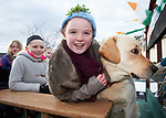 Shauna O Neill and Shannon Beston with dog Prince on their float at the St Patrick's Day parade in Scariff. Photograph by John Kelly.