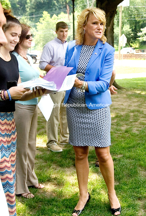 NAUGATUCK CT. 13 July 2015-071315SV05-Deputy Mayor Tamath Rossi speaks and hands out her notes during a news conference to outline her platform for the mayoral election on the green in Naugatuck Monday..<br /> Steven Valenti Republican-American