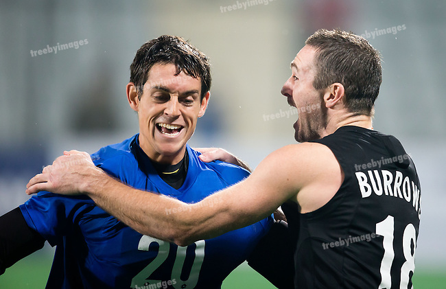 Mens Hockey World league Final Delhi 2014<br /> Day 5, 17-01-2014<br /> England v New Zealand<br /> Phil Burrows and GK George Manchester<br /> <br /> Photo: Grant Treeby / treebyimages