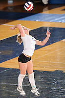 20 November 2008:  New Orleans setter Cassidy Asebroek (11) serves during the New Orleans 3-1 victory over UALR in the first round of the Sun Belt Conference Championship tournament at FIU Stadium in Miami, Florida.