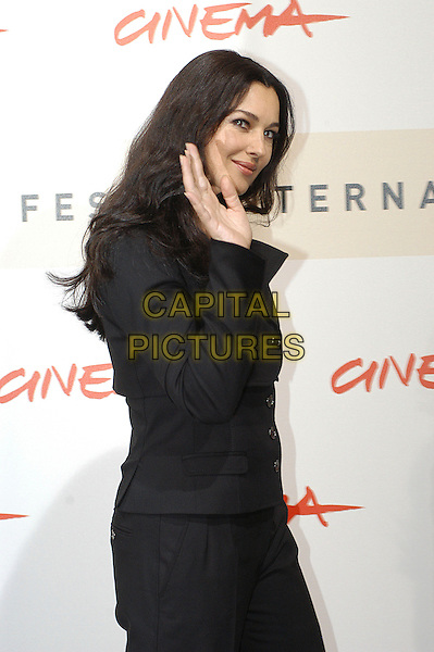 """MONICA BELLUCCI.Photocall for """"Le Deuxieme Souffle"""" at the 2nd Rome Film Festival, Rome, Italy..October 18th, 2007.half length black shirt hand palm waving .CAP/CAV.©Luca Cavallari/Capital Pictures."""
