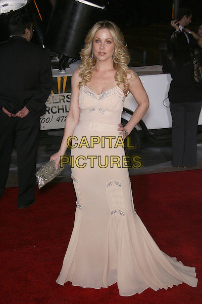 CHRISTINA APPLEGATE.The 33rd Annual People's Choice Awards - Arrivals held at The Shrine Auditorium, Los Angeles, California, USA..January 9th, 2007.full length beige cream dress silver clutch purse hand on hip.CAP/ADM/ZL.©Zach Lipp/AdMedia/Capital Pictures
