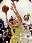 NAUGATUCK CT. 11 December 2018-121018SV12-#5 Paige Carroll of Sacred Heart goes up for a shot as #0 Sarah Wisniewski of Naugatuck defends during 2nd quarter NVL basketball action in Naugatuck Tuesday.<br /> Steven Valenti Republican-American