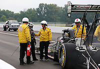 Sept. 2, 2013; Clermont, IN, USA: Safety safari members help NHRA top fuel dragster driver Brittany Force during the US Nationals at Lucas Oil Raceway. Mandatory Credit: Mark J. Rebilas-
