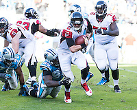 The Carolina Panthers defeated the Atlanta Falcons 34-10 in an inter-division rivalry played in Charlotte, NC at Bank of America Stadium.  Atlanta Falcons quarterback Matt Ryan (2) is sacked by Carolina Panthers defensive end Charles Johnson (95)