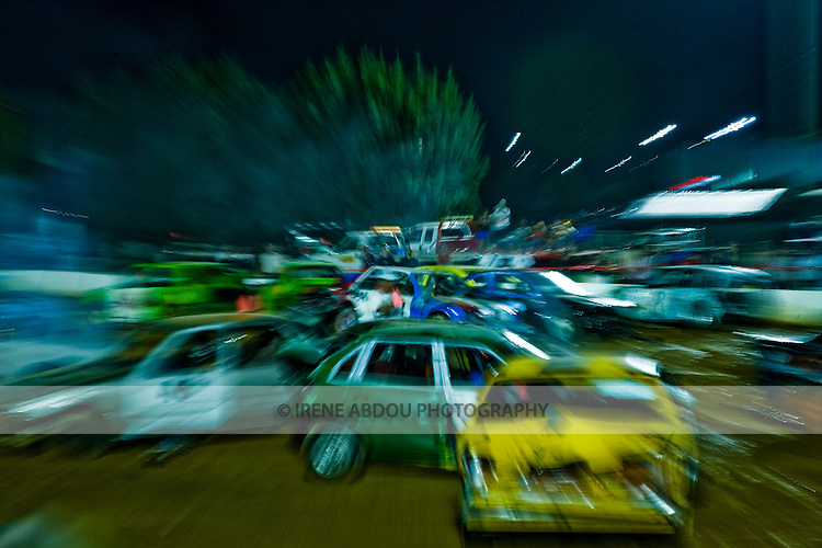 An in-camera zoom blur of this demoliton derby at the 2007 Montgomery County Agricultural Fair was created by zooming the camera lens while pressing the shutter button.  A slower shutter speed is required to capture the zoom effect.  In this image, a shutter speed of 1/4 second was used.