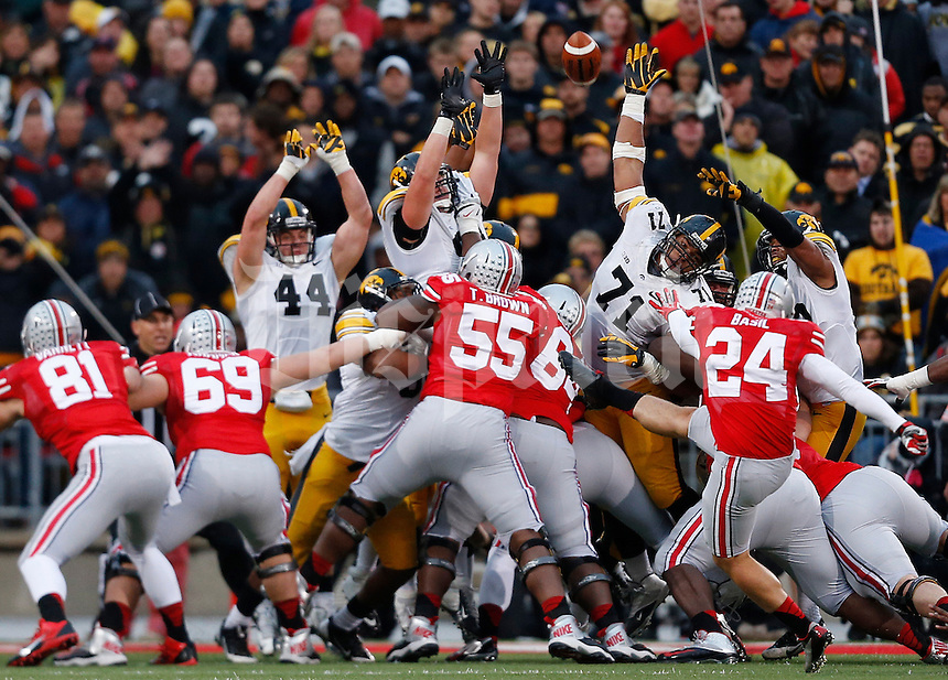 Ohio State Buckeyes kicker Drew Basil (24) kicks a field goal in the fourth quarter of the NCAA football game between the Ohio State Buckeyes and the Iowa Hawkeyes at Ohio Stadium in Columbus, Saturday afternoon, October 19, 2013. The Ohio State Buckeyes defeated the Iowa Hawkeyes 34 - 24.  (The Columbus Dispatch / Eamon Queeney)