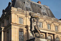 The Cour de la Fontaine with the statue of Ulysses from the fountain in the foreground, 16th century, Chateau de Fontainebleau, France. The Palace of Fontainebleau is one of the largest French royal palaces and was begun in the early 16th century for Francois I. It was listed as a UNESCO World Heritage Site in 1981. Picture by Manuel Cohen