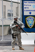 Marines armed with assault rifles provide a security presence at the World Trade Center PATH station in addition to that of Port Authority police.