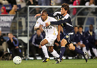 Darlington Naqbe #6 of the University of Akron is held by Adam Shaw #5 of the University of Michigan during the 2010 College Cup semi-final at Harder Stadium, on December 10 2010, in Santa Barbara, California. Akron won 2-1.
