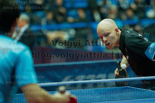 Hong Kong's Wong Chun Ting (front) plays against .Hungary's Gergely Perei (back) during the qualifier of the ITTF World Tour Hungarian Open in Budapest, Hungary on January 17, 2012. ATTILA VOLGYI