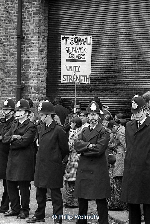 Police surround a picket line outside  the Grunwick film processing plant in Neasden, West London, during a two-year strike called in protest at management refusal to recognise trade union representation of the largely female Asian workforce.