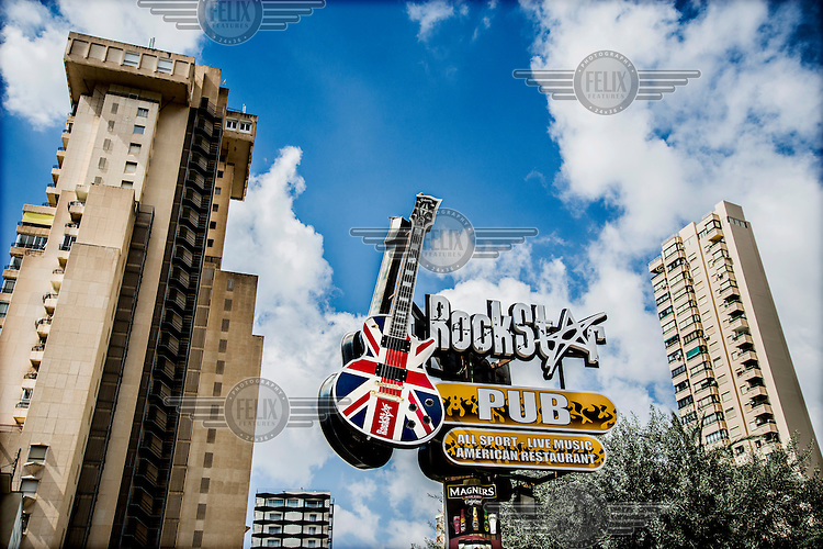 A huge replica Gibson guitar decorated with a Union Jack advertises the Rockstar Pub near the Levante (east) beach. Spain is home to more British ex-pats than anywhere else in the world, mostly concentrated in its Mediterranean regions.