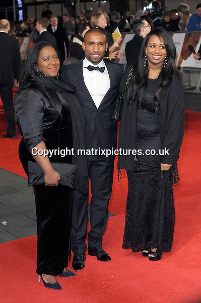 NON EXCLUSIVE PICTURE: PAUL TREADWAY / MATRIXPICTURES.CO.UK<br /> PLEASE CREDIT ALL USES<br /> <br /> WORLD RIGHTS<br /> <br /> English professional footballer Jermain Defoe attends the Royal film performance of &quot;Mandela: Long Walk to Freedom&quot; at the Odeon Theatre at Leicester Square in London, England.<br /> <br /> DECEMBER 5th 2013<br /> <br /> REF: PTY 137771