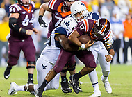 Landover, MD - SEPT 3, 2017: Virginia Tech Hokies quarterback Josh Jackson (17) is sacked by West Virginia Mountaineers cornerback Jacquez Adams (32) during game between West Virginia and Virginia Tech at FedEx Field in Landover, MD. (Photo by Phil Peters/Media Images International)