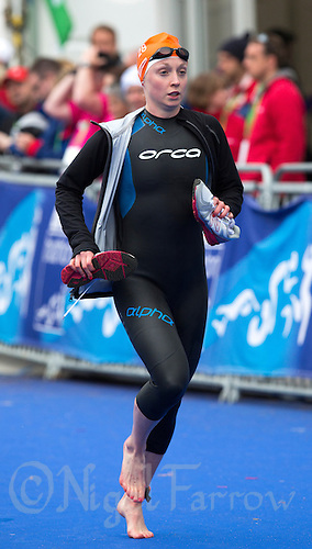 31 MAY 2015 - LONDON, GBR - Non Stanford (GBR) from Great Britain is called onto the pontoon for the start of the elite women's 2015 ITU World Triathlon Series round in Hyde Park, London, Great Britain(PHOTO COPYRIGHT © 2015 NIGEL FARROW, ALL RIGHTS RESERVED)