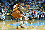 18 December 2013: North Carolina's Marcus Paige (5) is guarded by Texas' Jonathan Holmes (10). The University of North Carolina Tar Heels played the University of Texas Longhorns at the Dean E. Smith Center in Chapel Hill, North Carolina in a 2013-14 NCAA Division I Men's Basketball game.