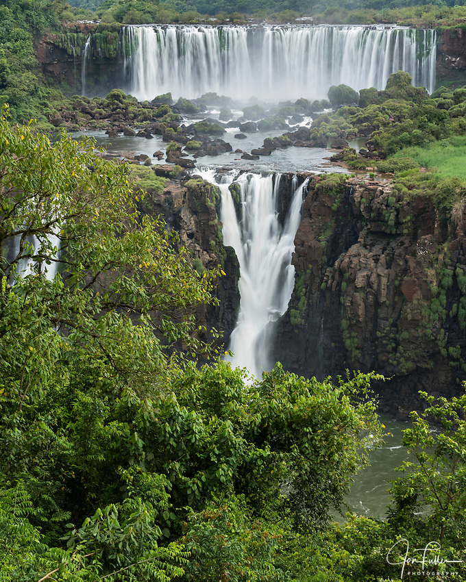 Iguazu Falls National Park in Argentina, as viewed from Brazil.  A UNESCO World Heritage Site.  Pictured  Rivadavia Falls at top with one of the Three Musketeers Falls or Salto Tres Mosqueteros below.