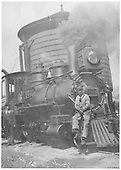 RGS 2-8-0 #12 at water tank with engineer and fireman posing for the photographer.<br /> RGS