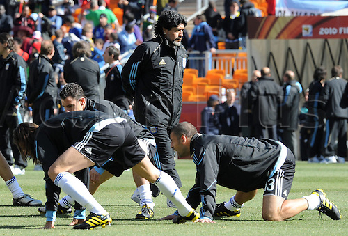 Argentina's coach Diego Armando Maradona (C) observes his players during warm up prior to the 2010 FIFA World Cup group B match between Argentina and South Korea at Soccer City Stadium in Johannesburg, South Africa 17 June 2010.