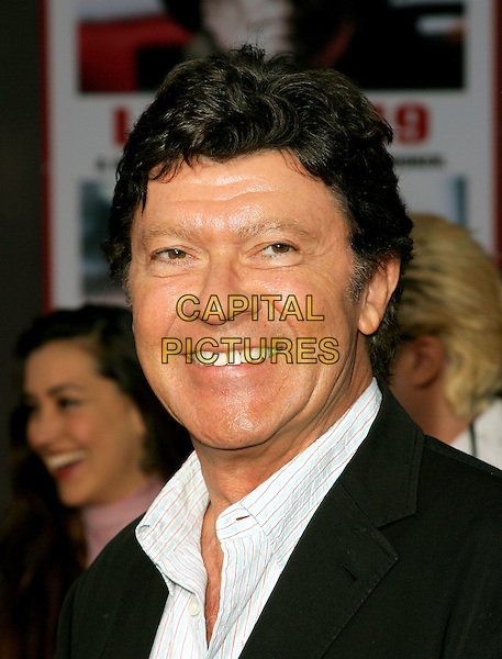 ROBBIE ROBERTSON.The World Premiere of Ladder 49 held at The El Capitan Theatre in Hollywood, California.September 20, 2004.headshot, portrait.www.capitalpictures.com.sales@capitalpictures.com.Copyright Debbie VanStory