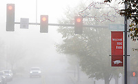 NWA Democrat-Gazette/DAVID GOTTSCHALK  Visibility is limited Monday, November 2, 2015, as the fog continues to lift in near the intersection of West Avenue and Dickson Street in Fayetteville.