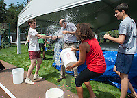 President Jonathan Veitch starts the annual water balloon fight against graduating seniors. Commencement rehearsal for the Occidental College class of 2013 on Friday, May 17 2013. (Photo by Marc Campos, Occidental College Photographer)