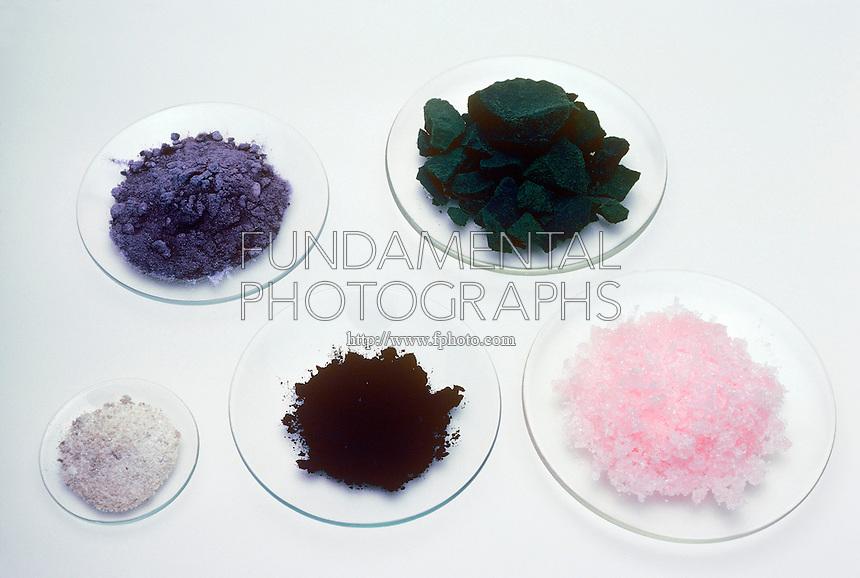 CHLORIDES OF TRANSITION METALS<br /> Crystals of the Chlorides of Transition Metals<br /> Clockwise from top left: titanium chloride, cupric chloride, manganese chloride tetrahydrate, vanadium chloride, scandium chloride.