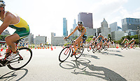 29 JUN 2014 - CHICAGO, USA - Diogo Sclebin (BRA) (centre) of Brazil takes a corner on the bike during the elite men's ITU 2014 World Triathlon Series round in Grant Park, Chicago in the USA (PHOTO COPYRIGHT © 2014 NIGEL FARROW, ALL RIGHTS RESERVED)