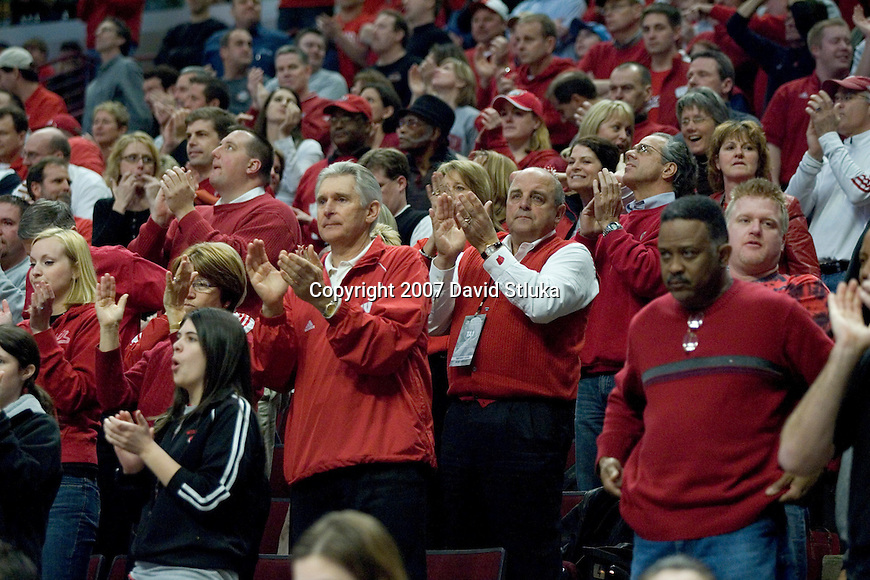CHICAGO - MARCH 16: Fans of the Wisconsin Badgers cheer during the game against the Texas A&M - Corpus Christi Islanders during the first round of the NCAA Men's Basketball Tournament at the United Center on March 16, 2007 in Chicago, Illinois. The Badgers beat the Islanders 76-63. (Photo by David Stluka)