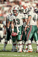 MIAMI, FL - DEC 19, 1999: Quarterback Dan Marino, #13, is shown on the field as his Miami Dolphins defeat the San Diego Chargers 12-9 at Joe Robbie Stadium, in Miami, FL. (Photo by Brian Cleary/www.bcpix.com)